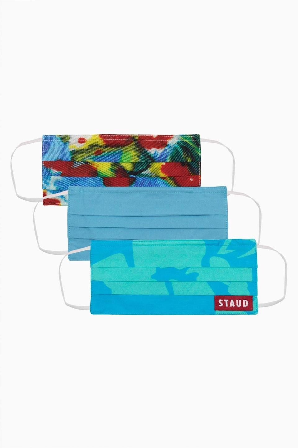 """<p><strong>Staud</strong></p><p>staud.clothing</p><p><strong>$30.00</strong></p><p><a href=""""https://go.redirectingat.com?id=74968X1596630&url=https%3A%2F%2Fstaud.clothing%2Fproducts%2Fpoplin-mask-set-blue-floral%3Fvariant%3D32481348157521%26ranMID%3D44120%26ranEAID%3Dtv2R4u9rImY%26ranSiteID%3Dtv2R4u9rImY-X.nm9EngMNOIu_bgQamNHA&sref=https%3A%2F%2Fwww.elle.com%2Ffashion%2Fshopping%2Fg32215868%2Ffashion-face-masks%2F"""" rel=""""nofollow noopener"""" target=""""_blank"""" data-ylk=""""slk:Shop Now"""" class=""""link rapid-noclick-resp"""">Shop Now</a></p><p>Opt for tropical prints with Staud's reusable styles. </p>"""