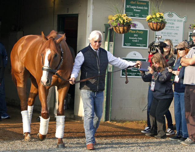 Bob Baffert leads Justify out of Barn 33 at Churchill Downs the morning after winning the 144th Kentucky Derby. (AP)