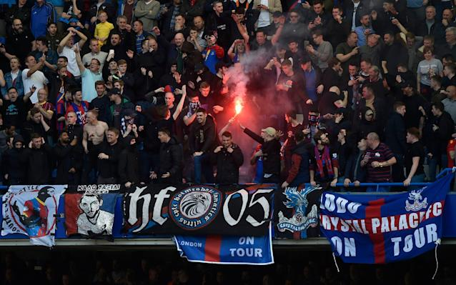 <span>Crystal Palace fans celebrate going ahead with a flare</span> <span>Credit: Reuters </span>