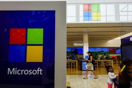Woman passes by a Microsoft store in Paramus, New Jersey