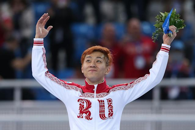 SOCHI, RUSSIA - FEBRUARY 15: Gold medallist Victor An of Russia stands on the podium during the flower ceremony after the Men's 1000 m Final Short Track Speed Skating on day 8 of the Sochi 2014 Winter Olympics at the Iceberg Skating Palace on February 15, 2014 in Sochi, Russia. (Photo by Matthew Stockman/Getty Images)