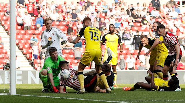 "Soccer Football - Championship - Sunderland v Burton Albion - Stadium of Light, Sunderland, Britain - April 21, 2018 Sunderland's Paddy McNair scores a goal that is later disallowed Action Images/Lee Smith EDITORIAL USE ONLY. No use with unauthorized audio, video, data, fixture lists, club/league logos or ""live"" services. Online in-match use limited to 75 images, no video emulation. No use in betting, games or single club/league/player publications. Please contact your account representative for further details."