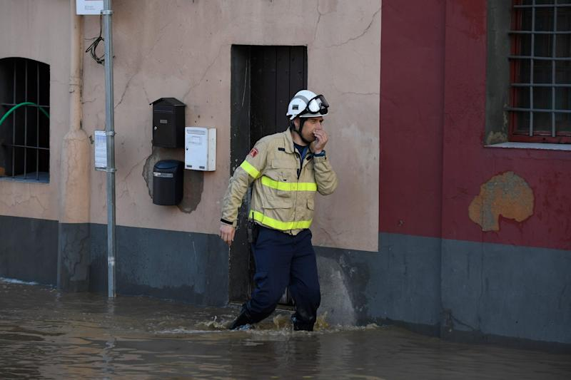 A fireman walks on a flooded street in Sarria de Ter on January 23 as storm Gloria batters Spanish eastern coast: AFP via Getty Images
