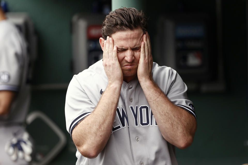 Yankees pitcher Zack Britton reacts in the dugout after giving up the go-ahead sacrifice fly during the eighth inning of their 5-4 loss to the Boston Red Sox on Sunday. (Photo By Winslow Townson/Getty Images)
