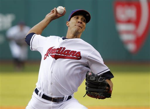 Cleveland Indians starting pitcher Ubaldo Jimenez throws against the Seattle Mariners during the first inning of a baseball game in Cleveland on Wednesday, May 16, 2012. (AP Photo/Amy Sancetta)
