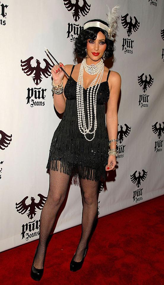 <p>Kim Kardashian was also in attendance at the 2008 Pur Jeans Halloween party in Los Angeles. For the event, Kim dressed as a 1920s flapper girl. <em>[Photo: Getty]</em> </p>
