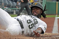 Pittsburgh Pirates' Josh Bell scores on an RBI double by Melky Cabrera, off Colorado Rockies starting pitcher Antonio Senzatela, during the first inning of a baseball game in Pittsburgh, Thursday, May 23, 2019. (AP Photo/Gene J. Puskar)