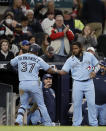 Toronto Blue Jays' Teoscar Hernandez (37) celebrates with Vladimir Guerrero Jr., right, after hitting a two-run home run against the Atlanta Braves during the ninth inning of a baseball game Wednesday, May 12, 2021, in Atlanta. (AP Photo/Ben Margot)