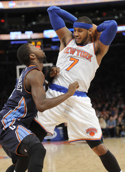 New York Knicks' Carmelo Anthony, right, makes a move as he is guarded by Charlotte Bobcats' Michael Kidd-Gilchrist during the second quarter of an NBA basketball game, Friday, Jan. 24, 2014, at Madison Square Garden in New York. Anthony scored 62 points as the Knicks defeated the Bobcats 125-96. (AP Photo/Bill Kostroun)