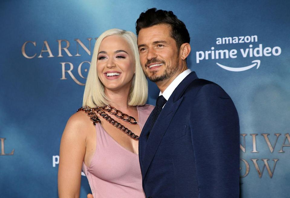 """<p>Katy Perry and Orlando Bloom have always kept it cool. They <a href=""""https://www.elle.com/culture/celebrities/a26358205/katy-perry-orlando-bloom-relationship-timeline/"""" rel=""""nofollow noopener"""" target=""""_blank"""" data-ylk=""""slk:started dating in 2016"""" class=""""link rapid-noclick-resp"""">started dating in 2016</a>, but called it off after 10 months. Despite their breakup, the two remained friends and refused to speak ill of each other. (I mean, Katy did say Orlando was <a href=""""https://youtu.be/7ZCF8s9FkUA"""" rel=""""nofollow noopener"""" target=""""_blank"""" data-ylk=""""slk:second best in bed"""" class=""""link rapid-noclick-resp"""">second best in bed</a> behind John Mayer.) After reconnecting romantically in early 2018, the duo <a href=""""https://www.instagram.com/p/Bt5gRBDHNZl/?utm_source=ig_embed"""" rel=""""nofollow noopener"""" target=""""_blank"""" data-ylk=""""slk:announced their engagement"""" class=""""link rapid-noclick-resp"""">announced their engagement</a> around Valentine's Day. The couple planned to wed in December, but were having some <a href=""""https://www.usmagazine.com/celebrity-news/news/why-katy-perry-and-orlando-bloom-postponed-their-wedding/"""" rel=""""nofollow noopener"""" target=""""_blank"""" data-ylk=""""slk:venue difficulties"""" class=""""link rapid-noclick-resp"""">venue difficulties</a>. Celebs have the same problems too, people.</p>"""