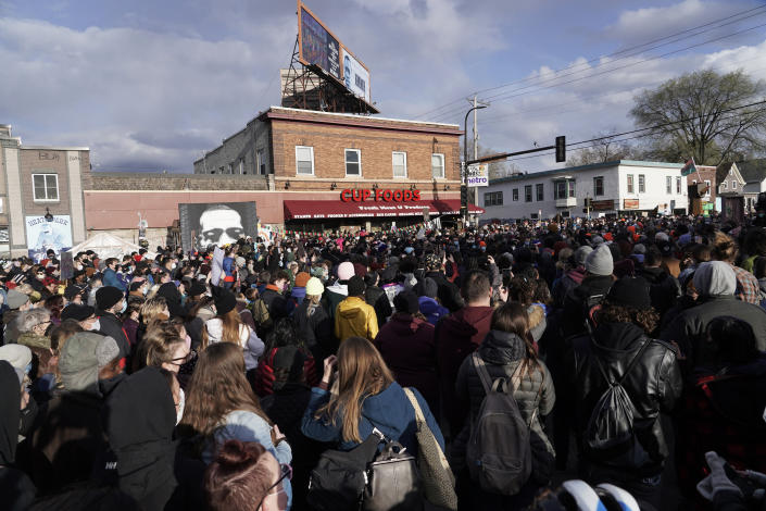 People gather at Cup Foods on April 20 after a guilty verdict was announced at the trial of former Minneapolis police Officer Derek Chauvin for the 2020 death of George Floyd. (Morry Gash/AP)