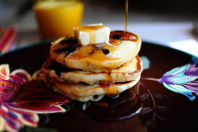 """<p>Cake flour and evaporated milk are the secrets to these light-and-fluffy pancakes. Top Mom's stack (and yours!) with softened butter and warm syrup.</p><p><a href=""""https://www.thepioneerwoman.com/food-cooking/recipes/a11568/lemon-blueberry-pancakes/"""" rel=""""nofollow noopener"""" target=""""_blank"""" data-ylk=""""slk:Get the recipe."""" class=""""link rapid-noclick-resp""""><strong>Get the recipe.</strong></a></p><p><a class=""""link rapid-noclick-resp"""" href=""""https://go.redirectingat.com?id=74968X1596630&url=https%3A%2F%2Fwww.walmart.com%2Fbrowse%2Fhome%2Felectric-griddles%2F4044_90548_90546_4828_8095122&sref=https%3A%2F%2Fwww.thepioneerwoman.com%2Ffood-cooking%2Frecipes%2Fg36145857%2Fbreakfast-in-bed-recipes%2F"""" rel=""""nofollow noopener"""" target=""""_blank"""" data-ylk=""""slk:SHOP PANCAKE GRIDDLES"""">SHOP PANCAKE GRIDDLES</a></p>"""
