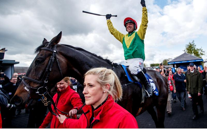 Robbie Power celebrates winning the Punchestown Gold Cup on Sizing John - Rex Features