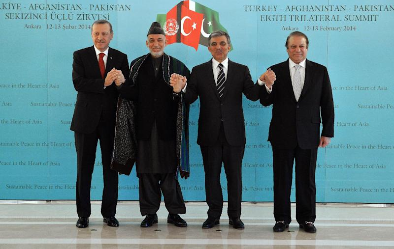 In this photo released by the Turkish Presidency Press Office, Turkish Abdullah Gul, second right, Turkish Prime Minister Recep Tayyip Erdogan, left, Afghan President Hamid Karzai, second left, and Pakistan Prime Minister Nawaz Sharif pose for cameras after their meeting in Ankara, Turkey, Thursday, Feb. 13, 2014. Karzai and Sharif are in Turkey for the 8th Afghanistan-Pakistan-Turkey Trilateral Summit.(AP Photo/Murat Cetinmuhurdar, Turkish Presidency Press Office, HO)