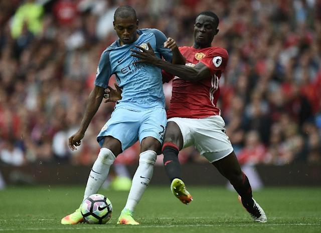 Manchester City's Fernandinho (L) fights for the ball with Manchester United's Eric Bailly during their English Premier League match, at Old Trafford, on September 10, 2016 (AFP Photo/Oli Scarff)