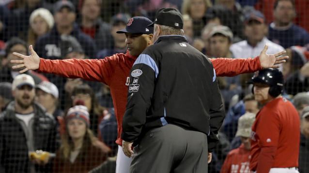 Boston Red Sox manager Alex Cora argues a strike three call with umpire Joe West during the fifth inning in Game 1 of a baseball American League Championship Series against the Houston Astros on Saturday, Oct. 13, 2018, in Boston. (AP Photo/Charles Krupa)