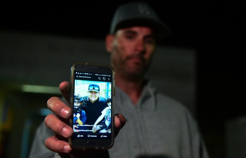 Jason Coffman displays a photo of his son Cody, who was shot and killed at the Borderline Bar & Grill on Nov. 7, 2018. (FREDERIC J. BROWN via Getty Images)