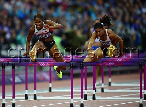 Canada's Phylicia George (left) competes in the women's 100-metre hurdle semifinals at the Olympic Stadium during the Summer Olympics in London on Tuesday, August 7, 2012. THE CANADIAN PRESS/Sean Kilpatrick