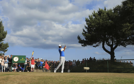 Tiger Woods of the US plays off the 11th tee during the first round of the British Open Golf Championship in Carnoustie, Scotland, Thursday July 19, 2018. (AP Photo/Jon Super)