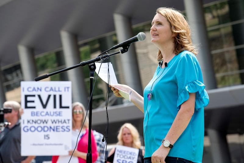 Mary DeMuth, a rape survivor who's an advocate for sexual abuse victims, speaks during a rally at the Southern Baptist Convention meeting in Dallas in 2018. (Photo: Jeffrey McWhorter / ASSOCIATED PRESS)