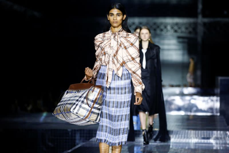 Models present creations during the Burberry catwalk show at London Fashion Week in London