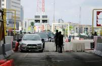 Cars drive through the Lekki toll gate in Lagos