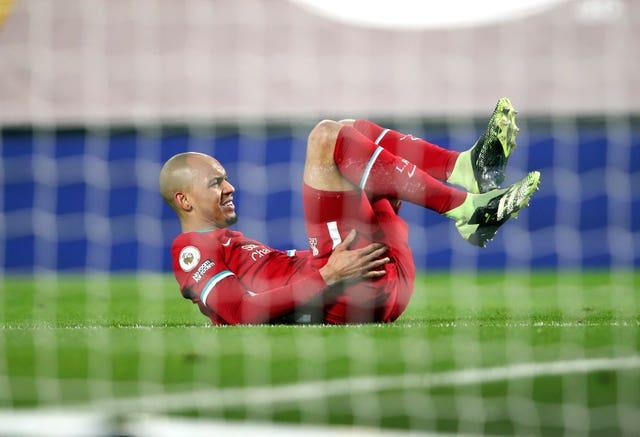 Fabinho lies on the floor holding his hamstring