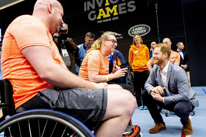 Prince Harry, here with athletes training in 2019, remains a supporter of the event, the organisers said. (AFP)