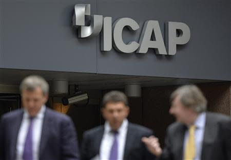 People walk past an ICAP office in the City of London September 25, 2013. REUTERS/Toby Melville