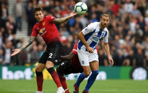 Victor Lindelof and Paul Pogba of Manchester United put pressure on Glenn Murray of Brighton - Credit: Getty