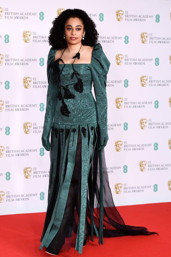 <p>The singer wore a fringed gown by Dilara Findikoglu. </p>