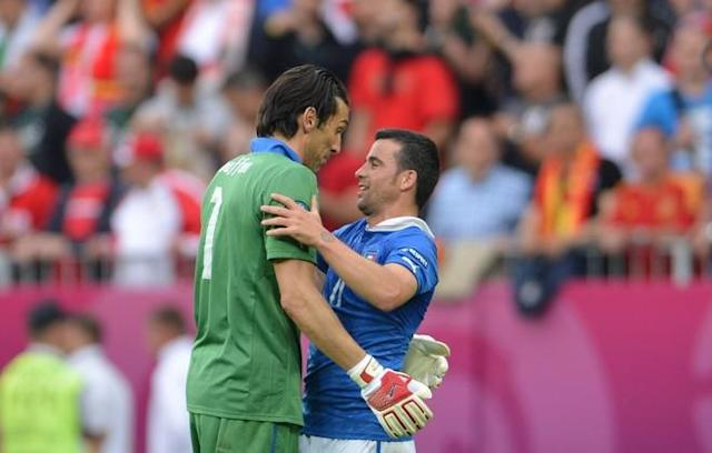 Italian goalkeeper Gianluigi Buffon (L) reacts with Italian forward Antonio Di Natale at the end of the Euro 2012 championships football match Spain vs Italy on June 10, 2012 at the Gdansk Arena. AFPPHOTO/ GIUSEPPE CACACEGIUSEPPE CACACE/AFP/GettyImages