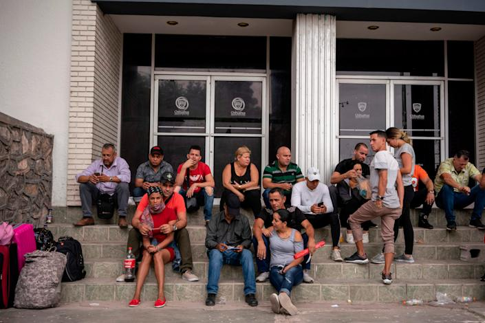 Cubans are pictured waiting outside of the Centro de Attention Integral de Migrantes office to register for their numbers to cross into the United States, in Ciudad Juarez, Chihuahua State, on May 20, 2019.