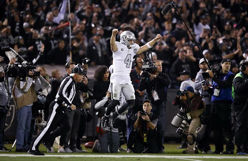 OAKLAND, CALIFORNIA - NOVEMBER 07: Derek Carr #4 of the Oakland Raiders celebrates after the Raiders intercepted a pass on fourth down at the end of the fourth quarter to clinch their vicotry over the Los Angeles Chargers at RingCentral Coliseum on November 07, 2019 in Oakland, California. (Photo by Ezra Shaw/Getty Images)