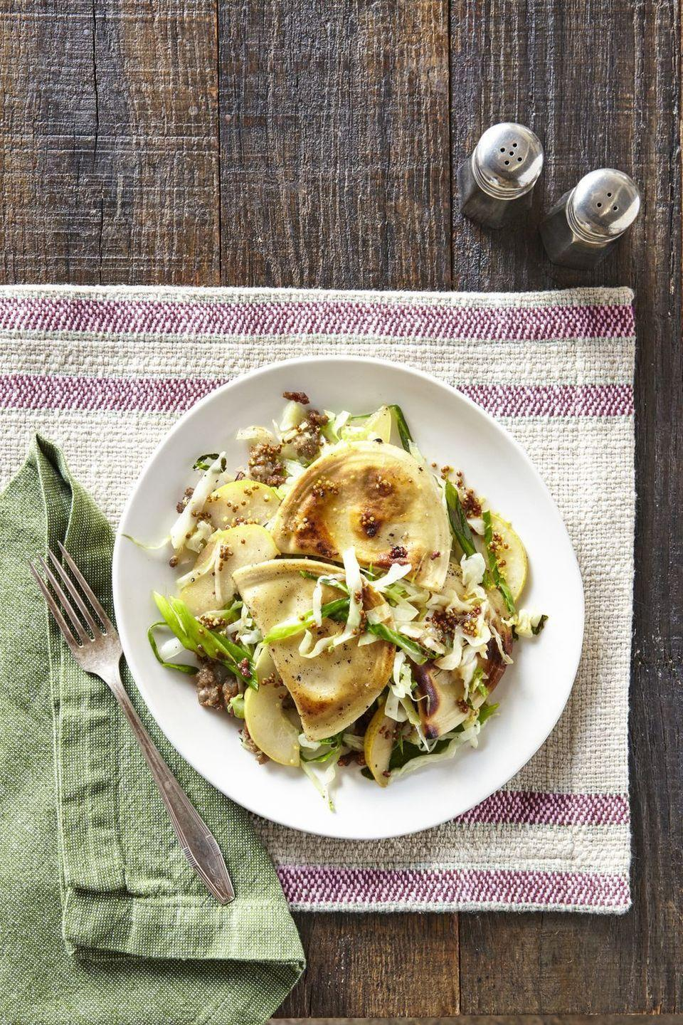 """<p>It's time to upgrade your easy weeknights eats (no, not chicken again!) with these potato-filled pockets topped with juicy sausage and served with a tangy salad.</p><p><em><a href=""""https://www.countryliving.com/food-drinks/recipes/a39829/pierogies-with-sausage-cabbage-pear-recipe/"""" rel=""""nofollow noopener"""" target=""""_blank"""" data-ylk=""""slk:Get the recipe from Country Living »"""" class=""""link rapid-noclick-resp"""">Get the recipe from Country Living »</a></em></p>"""