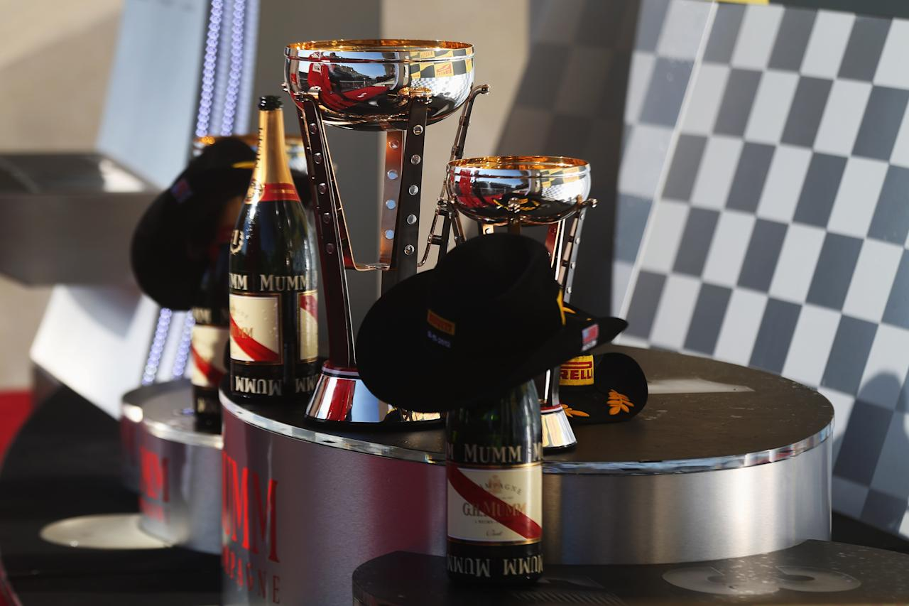 AUSTIN, TX - NOVEMBER 18:  Stetsons are seen alongside the trophies and champagne on the podium following the United States Formula One Grand Prix at the Circuit of the Americas on November 18, 2012 in Austin, Texas.  (Photo by Mark Thompson/Getty Images)