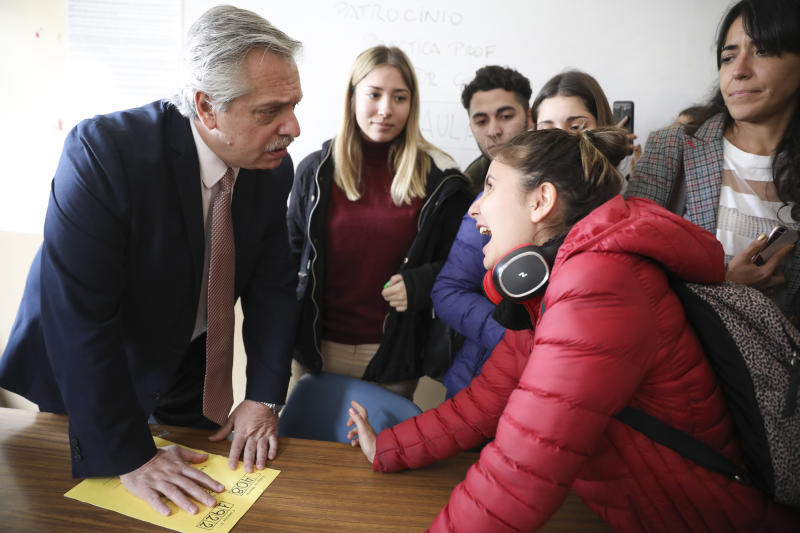 Argentina's presidential front-runner Alberto Fernandez listens to a student at the end of an oral exam in his classroom at the University of Buenos Aires School of Law, in Buenos Aires, Argentina, Wednesday, Oct. 16, 2019. The presidential ticket headed by Fernandez and his vice presidential running mate, former President Cristina Fernández, no relation, emerged as the strongest vote-getter in Argentina's primary elections in August, indicating conservative President Mauricio Macri will face an uphill battle going into the Oct. 27 general elections. (AP Photo/Natacha Pisarenko)