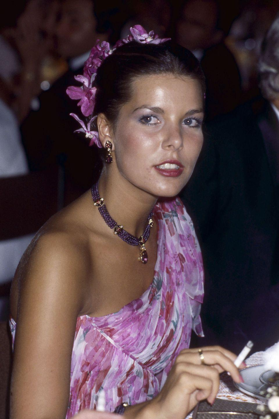 <p>Princess Caroline in orchids and amethysts at Monaco's annual Red Cross Ball in 1979.</p>