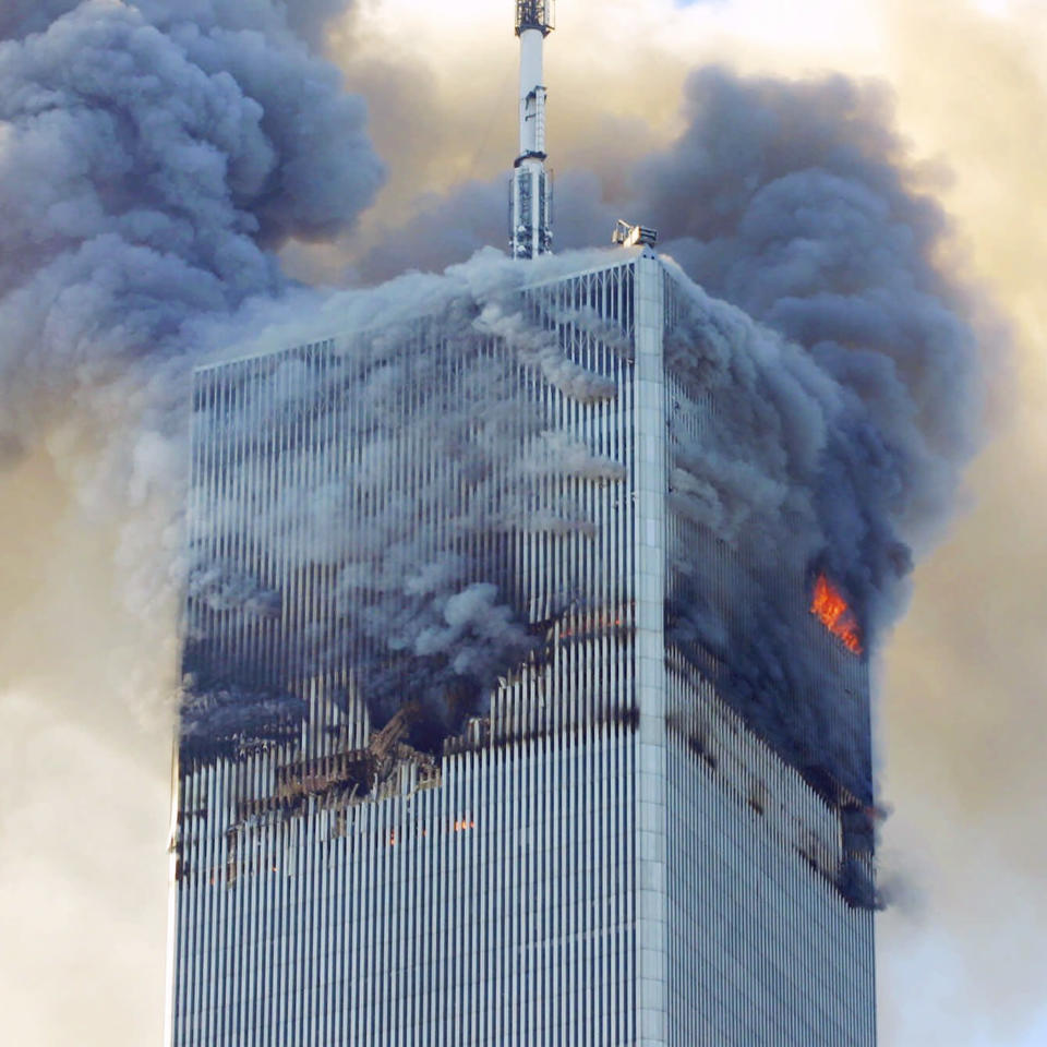 FILE - Fire and smoke billows from the north tower of New York's World Trade Center on Sept. 11, 2001 after terrorists crashed two hijacked airliners into the World Trade Center and brought down the twin towers. Most Americans were guided through the events of the day by one of three men: Tom Brokaw of NBC News, Peter Jennings of ABC and Dan Rather of CBS. Each had extensive reporting experience before that, Brokaw and Rather were at the White House during Watergate, and Jennings has been a foreign correspondent. (AP Photo/David Karp, File)