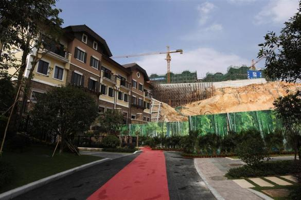 A general view of houses for sale at the replica village of Austria's UNESCO heritage site, Hallstatt, in China's southern city of Huizhou in Guangdong province, June 1, 2012. Metals and mining company China Minmetals Corporation spent $940 million to build this controversial site and hopes to attract both tourists and property investors alike.