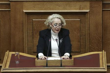 Supreme Court judge Thanou addresses a parliamentary session on the occasion of the International Women's Day in Athens