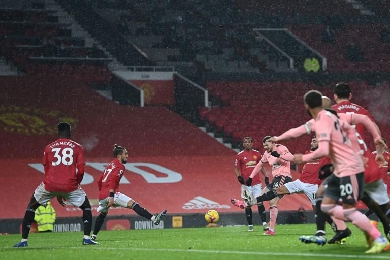 Oliver Burke (centre) scores for Sheffield United against Manchester United