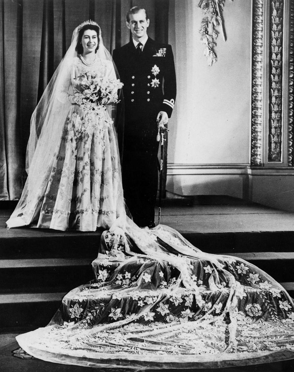 """<p>Elizabeth and Philip <a href=""""https://www.goodhousekeeping.com/beauty/fashion/g4919/queen-elizabeth-wedding-gown/"""" rel=""""nofollow noopener"""" target=""""_blank"""" data-ylk=""""slk:wed in Westminster Abbey"""" class=""""link rapid-noclick-resp"""">wed in Westminster Abbey</a> in front of 2,500 guests, with 200 million more people listening to the ceremony on the radio. </p>"""