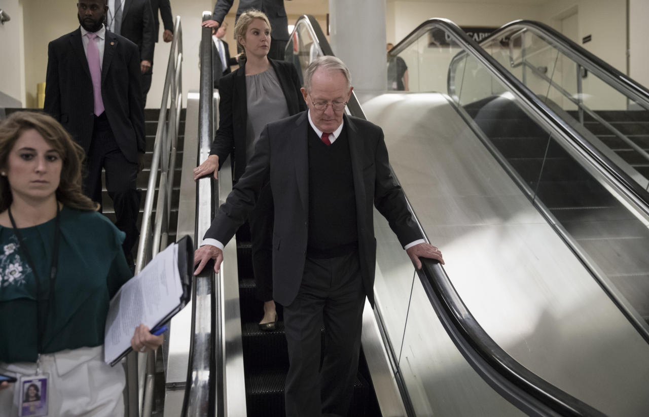 Sen. Lamar Alexander, R-Tenn., takes the escalator down as he returns to his office after appearing on the Senate floor with Sen. Patty Murray, D-Wash., to defend their bipartisan proposal for resuming federal subsidies to health insurers that President Donald Trump has blocked, at the Capitol in Washington, Thursday, Oct. 19, 2017. (AP Photo/J. Scott Applewhite)