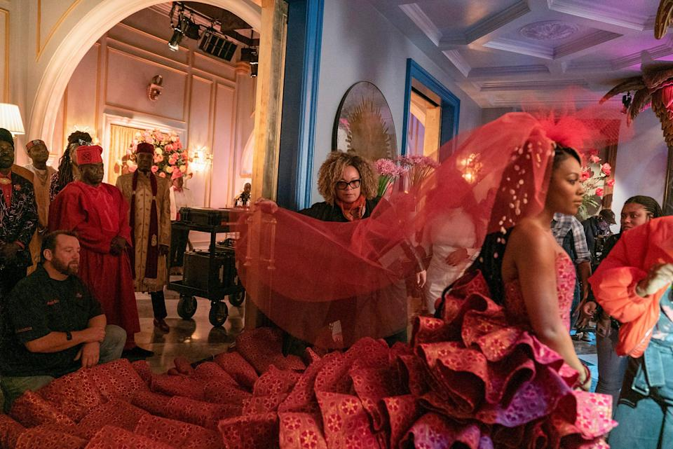 """Costume Designer Ruth Carter with Nomzamo Mbatha and the wedding dress on the set of """"Coming 2 America."""""""