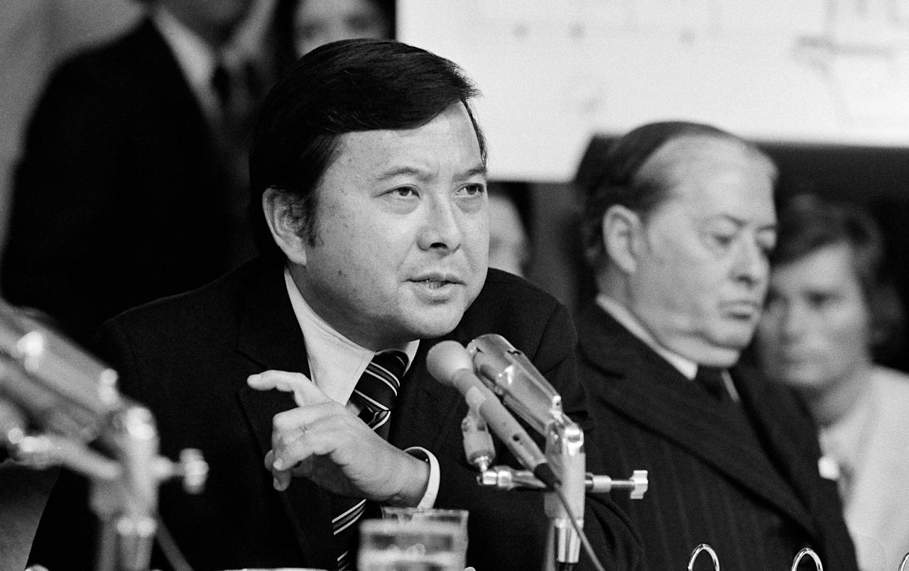 FILE - In this May 19, 1973 file photo, Sen. Daniel K. Inouye, D-Hawaii, a member of the Watergate investigating committee, questions witness James McCord during the hearing on Capitol Hill in Washington, as John M. Montoya, Democrat of New Mexico, is at right. Inouye, the influential Democrat who broke racial barriers on Capitol Hill and played key roles in congressional investigations of the Watergate and Iran-Contra scandals, died of respiratory complications, Monday, Dec. 17, 2012, according to his office. He was 88. (AP Photo/File)