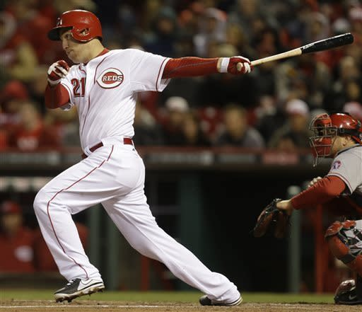 Cincinnati Reds' Todd Frazier (21) gets a hit off Los Angeles Angels starting pitcher C.J. Wilson to drive in a run in the fourth inning of a baseball game, Wednesday, April 3, 2013, in Cincinnati. (AP Photo/Al Behrman)