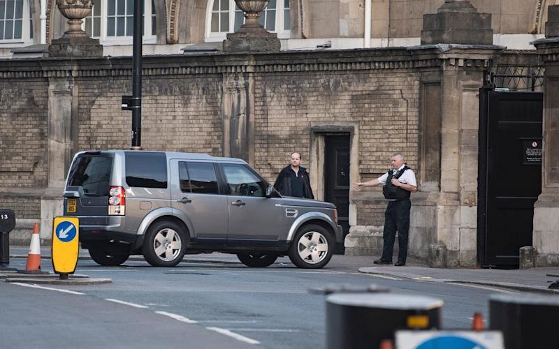 A car carrying the Prime Minister arrives at a side entrance to Buckingham Palace -  London News Pictures