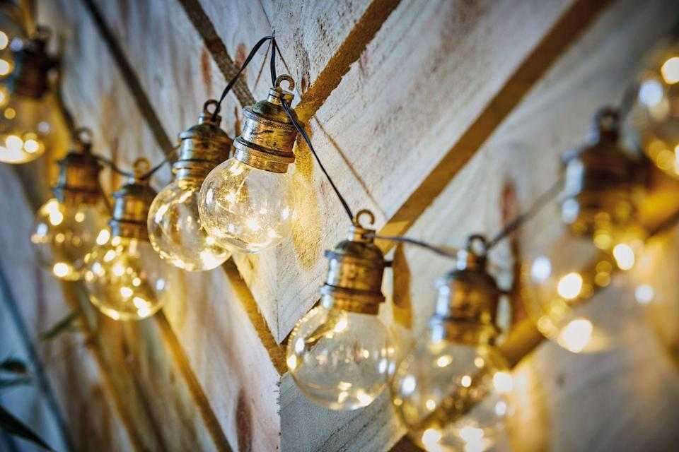 """<p>Create a glow in your garden with these solar festoon <a href=""""https://www.countryliving.com/uk/homes-interiors/gardens/g35977823/solar-fence-lights/"""" rel=""""nofollow noopener"""" target=""""_blank"""" data-ylk=""""slk:lights"""" class=""""link rapid-noclick-resp"""">lights</a> (£9.99), which get their energy from the sun. With a rustic feel, they are ideal for stringing along a fence. </p><p><a class=""""link rapid-noclick-resp"""" href=""""https://www.aldi.co.uk/c/specialbuys/garden-shop"""" rel=""""nofollow noopener"""" target=""""_blank"""" data-ylk=""""slk:SHOP NOW"""">SHOP NOW</a></p>"""