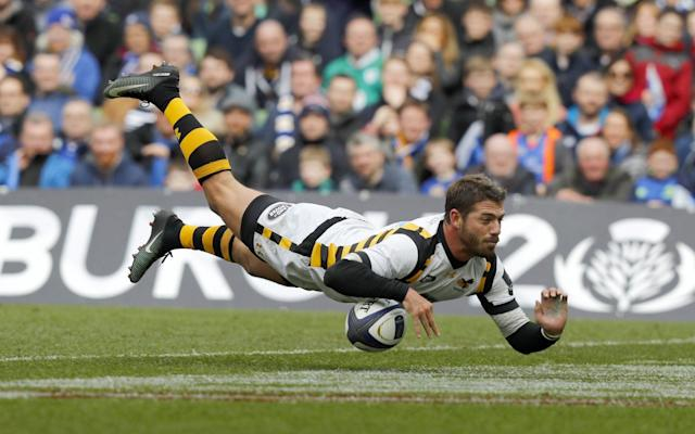 <span>Willie le Roux spills the ball while diving over the line</span> <span>Credit: REX FEATURES </span>